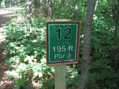 Poor House Farm Park, Main course, Hole 12 Hole sign