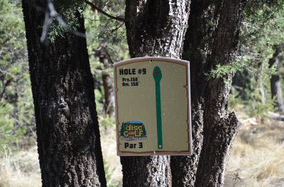 Camp of The Tall Pines, Main course, Hole 9 Hole sign
