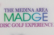 MADGE - The Medina Area Disc Golf Experience logo